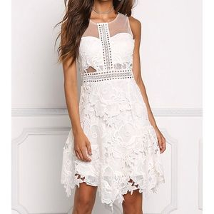 Dresses & Skirts - NWT-crocheted dress in a fit and flare style.